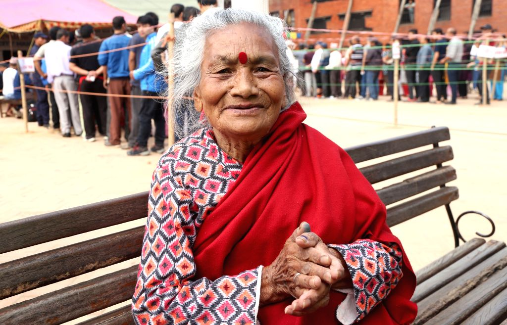 KATHMANDU, May 14, 2017 - A Nepali elderly smiles after casting her vote at a polling station during local elections in Kathmandu, Nepal on May 14, 2017. Voting began across Nepal in first round of ...
