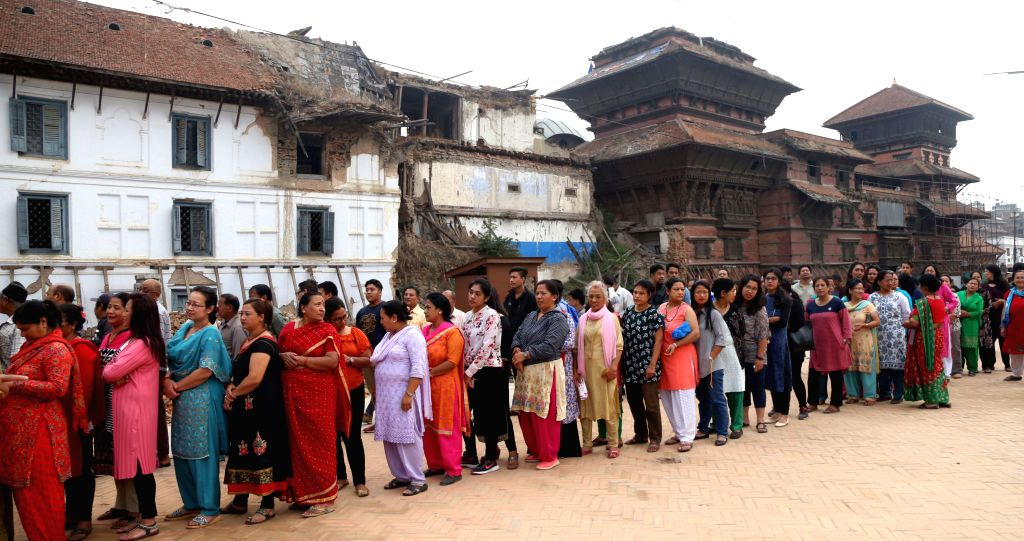 KATHMANDU, May 14, 2017 - Nepali people queue to cast their votes at a polling station during local elections in Kathmandu, Nepal on May 14, 2017. Voting began across Nepal in first round of ...
