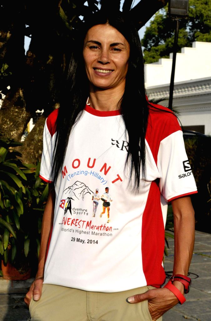 The first female runner Olfat Haider poses for a photo during a press conference of Everest Marathon in Kathmandu, Nepal, May 16, 2014. Around 107 international ...