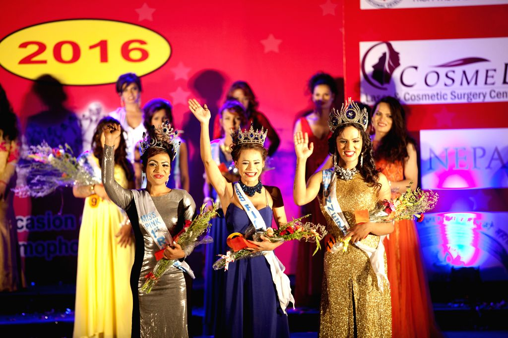 KATHMANDU, May 18, 2016 - Miss Pink Nepal 2016 title winner Annie Lama (C, front), first runner-up Pallavi Sharma (L, front) and second runner-up Akancha Timilsina (R, front) wave during the final of ... - Pallavi Sharma
