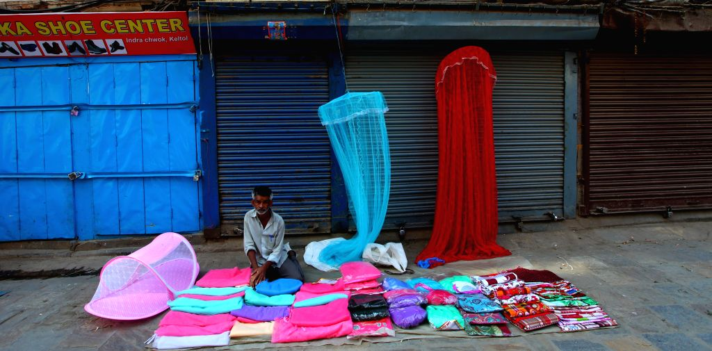 A local vendor sells mosquito nets in Kathmandu, capital of Nepal, on May 19, 2015. Nepalese people are normalizing their daily life after the massive earthquakes. ...