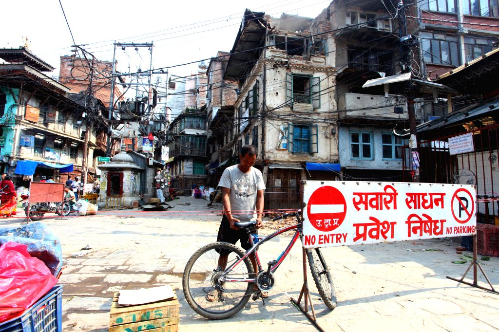 A resident places a bicycle at Ason in Kathmandu, Nepal, May 19, 2015.