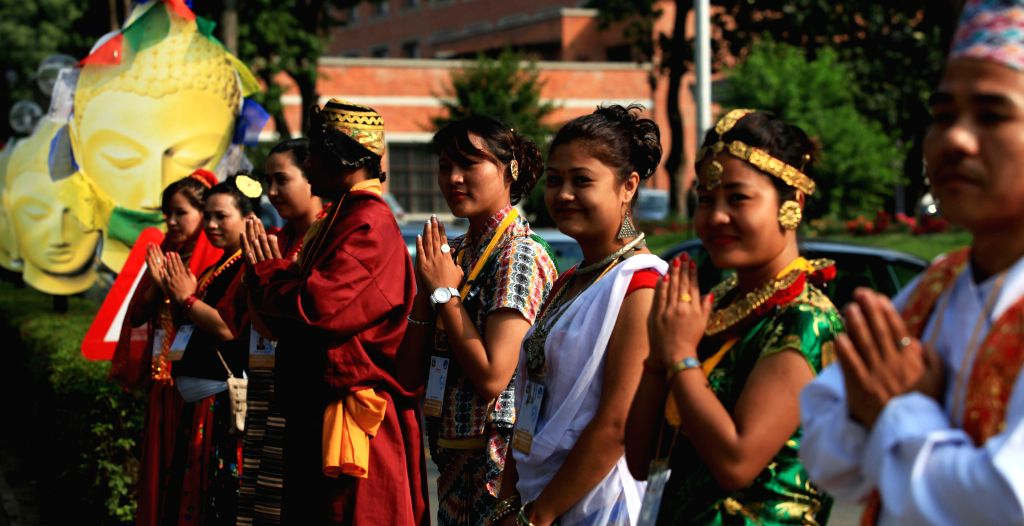 KATHMANDU, May 19, 2016 - Nepalese people in traditional attires welcome visitors during the inaugural session of the 2,560th Buddha Jayanti Celebration and the International Buddhist Conference in ... - K