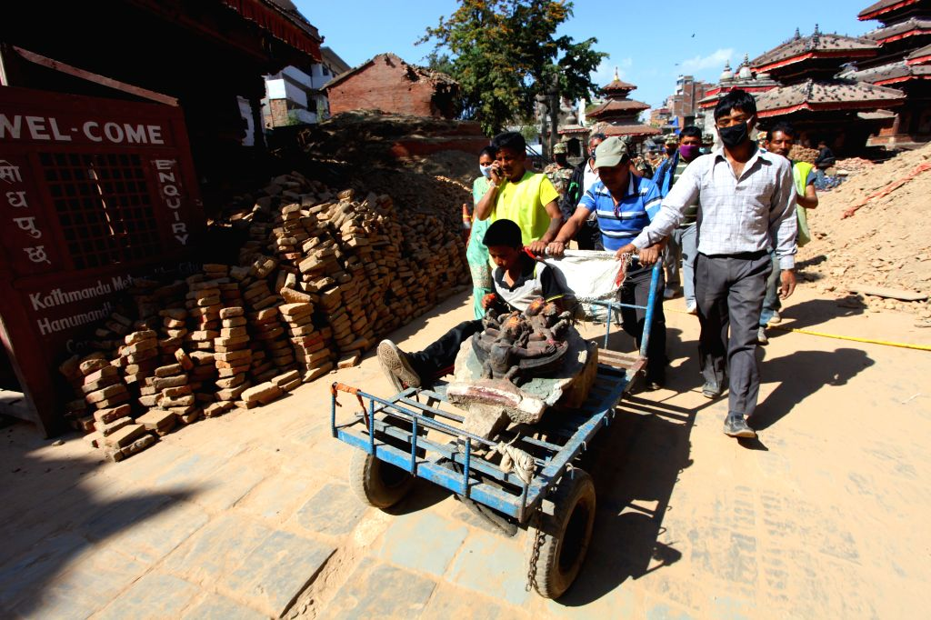 Rescuers take idols found from damaged temples to a museum in Kathmandu, Nepal, May 3, 2015. Death toll from the powerful earthquake in Nepal has climbed to 7,240 ...