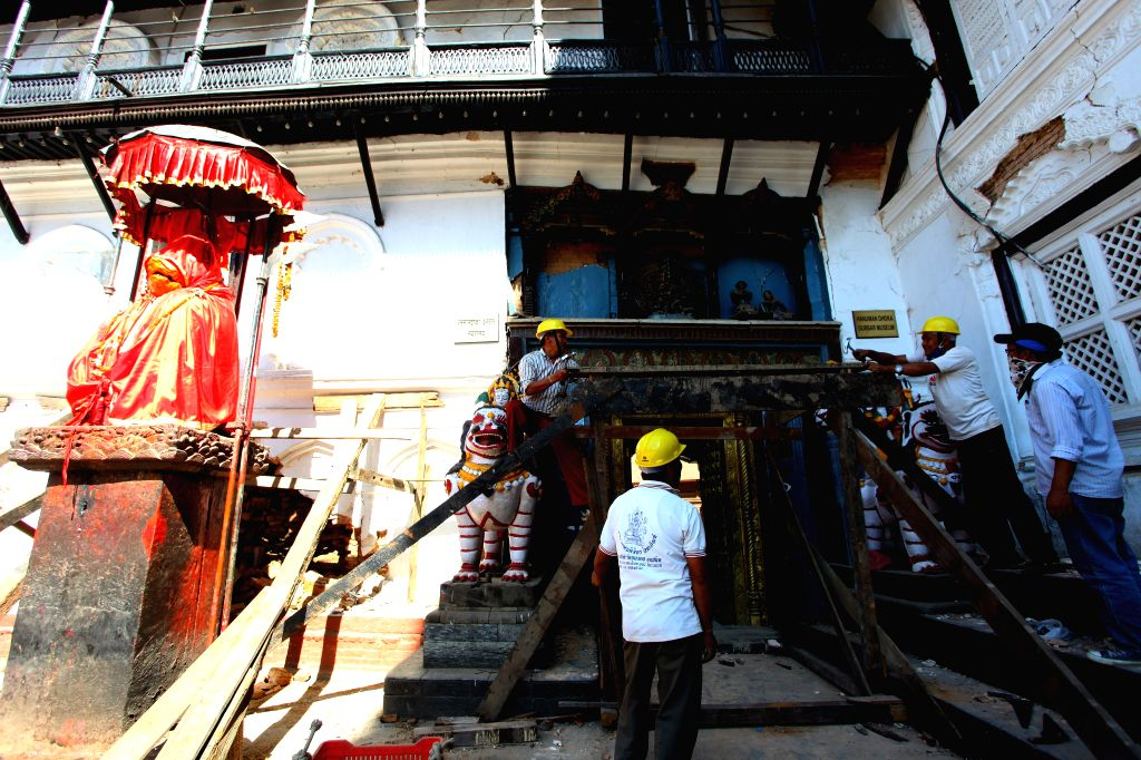 Workers repair a damaged building in Kathmandu, Nepal, May 3, 2015. Death toll from the powerful earthquake in Nepal has climbed to 7,240 on Sunday, the Ministry of ...