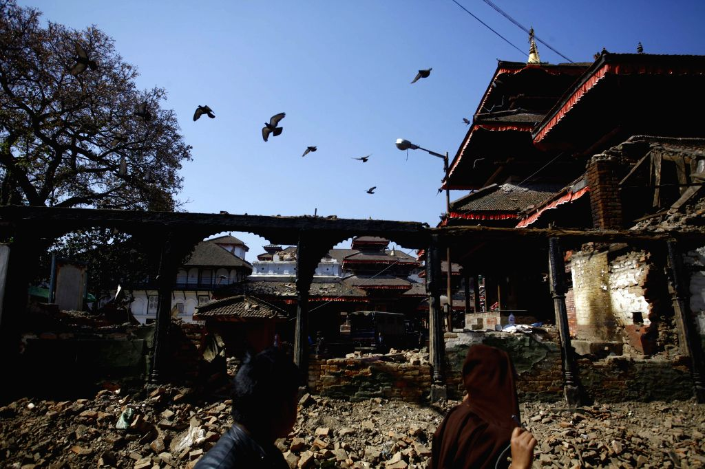 People pass through the Basantapur Durbar Square which was destructed by the earthquake in Kathmandu, Nepal, May 3, 2015. Death toll from the powerful earthquake in ...