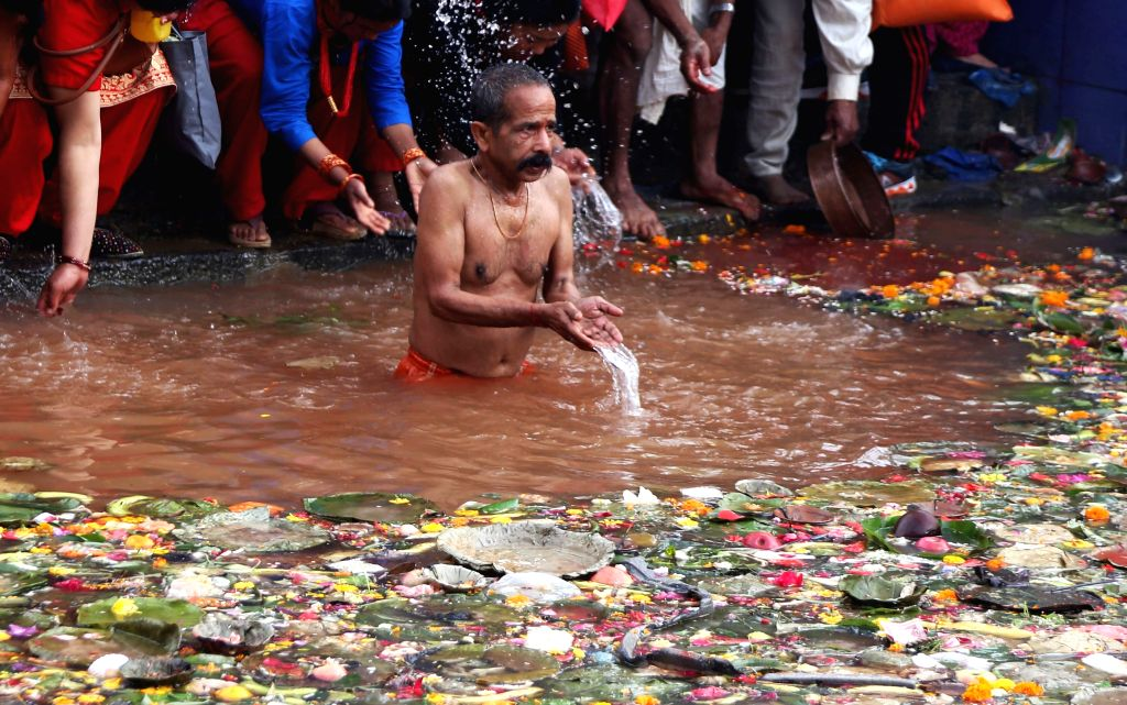 KATHMANDU, May 4, 2019 - A man takes a holy bath to offer prayers at a pond on Mother's Day, or Mata Tirtha Aunsi, at Matatirtha in Kathmandu, Nepal, May 4, 2019. Nepalese observe this day to show ...