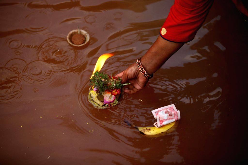 KATHMANDU, May 4, 2019 - A woman offers prayers after taking a holy bath at a pond on Mother's Day, or Mata Tirtha Aunsi, at Matatirtha in Kathmandu, Nepal, May 4, 2019. Nepalese observe this day to ...
