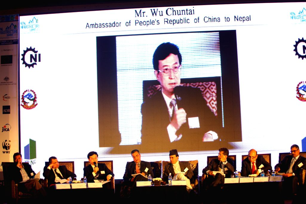 Kathmandu (Nepal): Chinese Ambassador to Nepal Wu Chuntai (3rd L) speaks during the Nepal Infrastructure Summit in Kathmandu, Nepal, Nov. 12, 2014. The summit, the first of its kind in Nepal with the