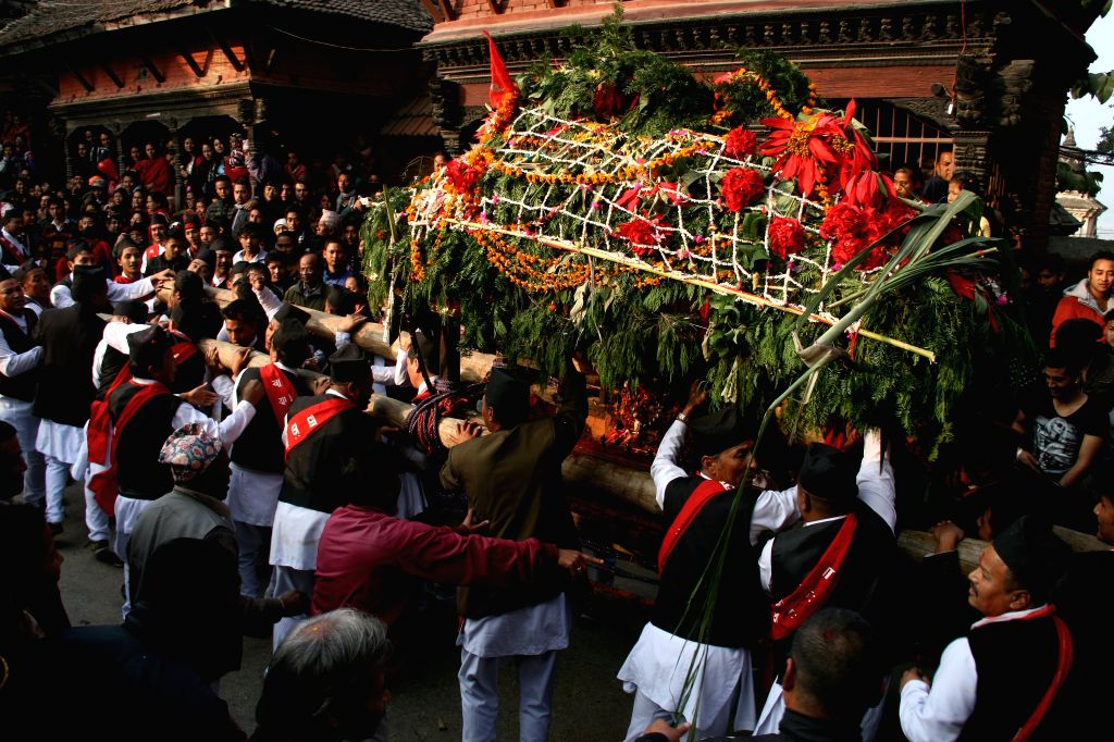 Kathmandu (Nepal): Devotees carry the chariot of an idol of the goddess Indrayani in the Indrayani Festival at Kirtipur, outskirts of Kathmandu, Nepal, Dec. 1, 2014. The festival is celebrated every .