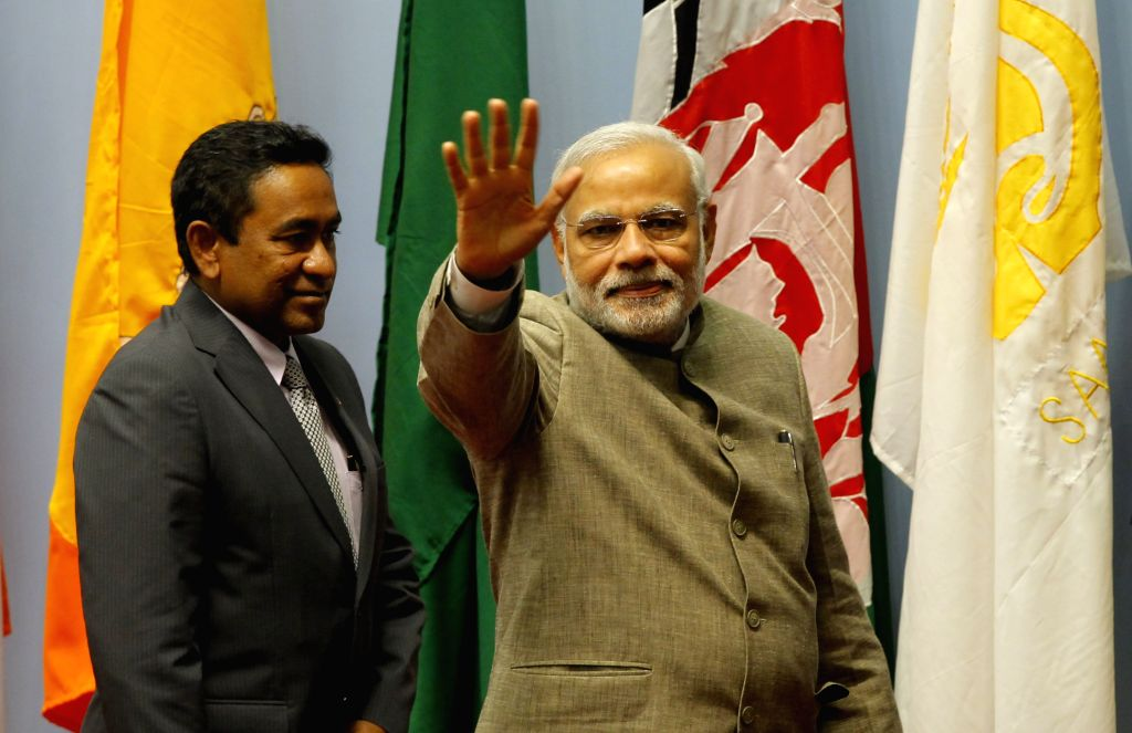 Kathmandu (Nepal): Indian Prime Minister Narendra Modi (R) gestures after the closing session of the 18th South Asian Association for Regional Cooperation (SAARC) summit at City Hall in Kathmandu, ... - Narendra Modi