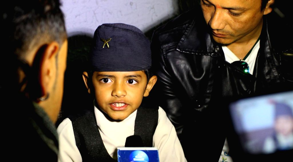 Kathmandu (Nepal): Nepalese eight-year-old kid Saugat Bista talks about his Nepali movie `Love You Baba` with media during its premiere in Kathmandu, Nepal, Dec. 9, 2014. Bista is in an attempt to be