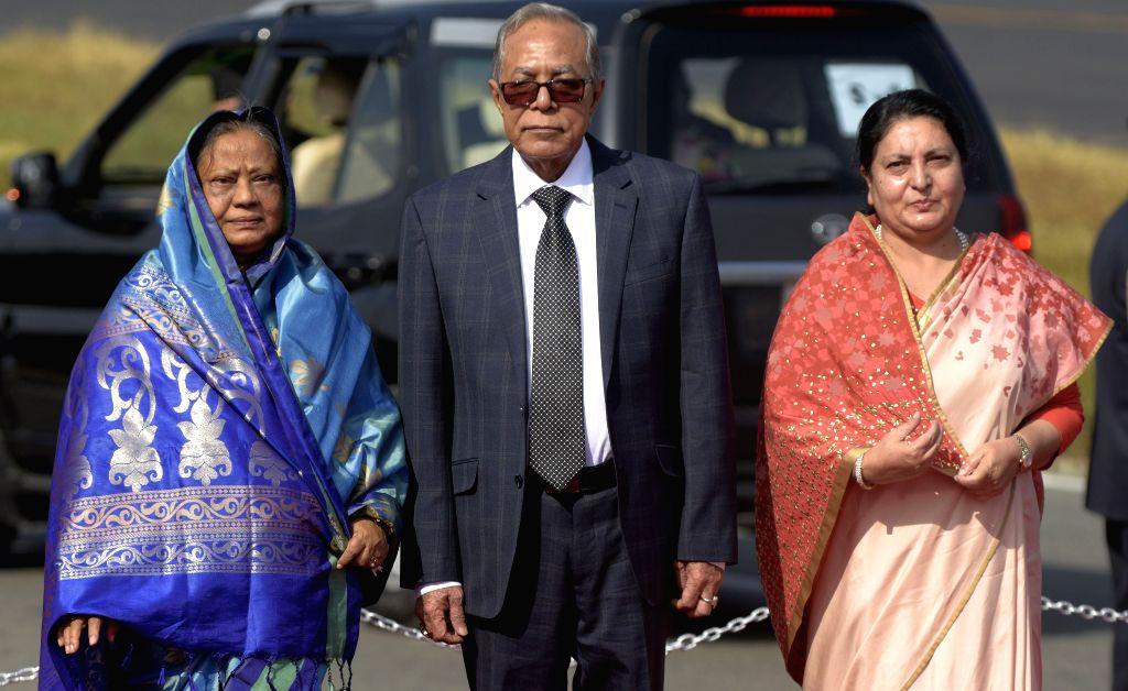 KATHMANDU, Nov. 12, 2019 - President of Bangladesh M Abdul Hamid (C) stands along with Nepali President Bidhya Devi Bhandari (R) at Tribhuvan International Airport in Kathmandu, capital of Nepal, ...
