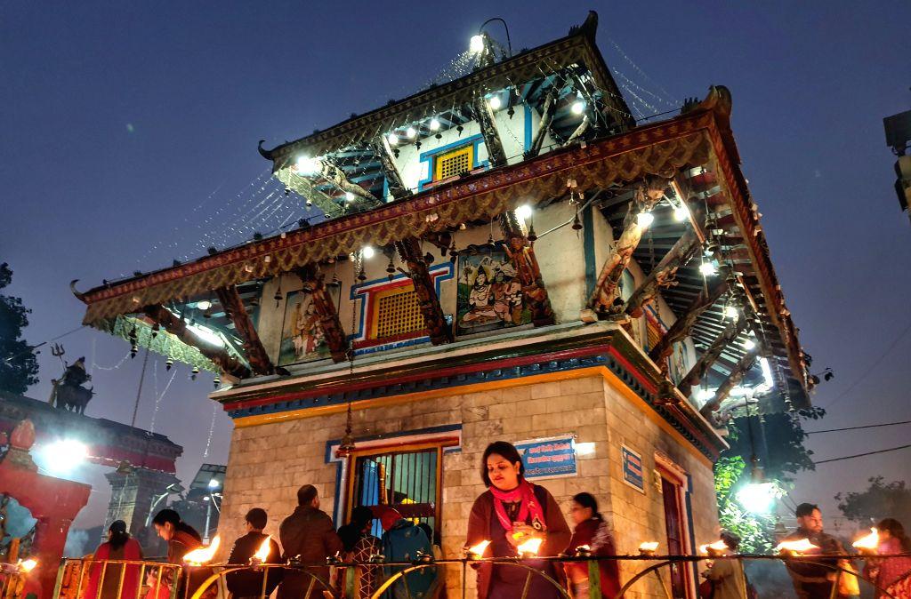 KATHMANDU, Nov. 13, 2019 - People offer prayers by lighting oil lamps on full moon day at Shiva temple in Kathmandu, Nepal, Nov. 12, 2019.