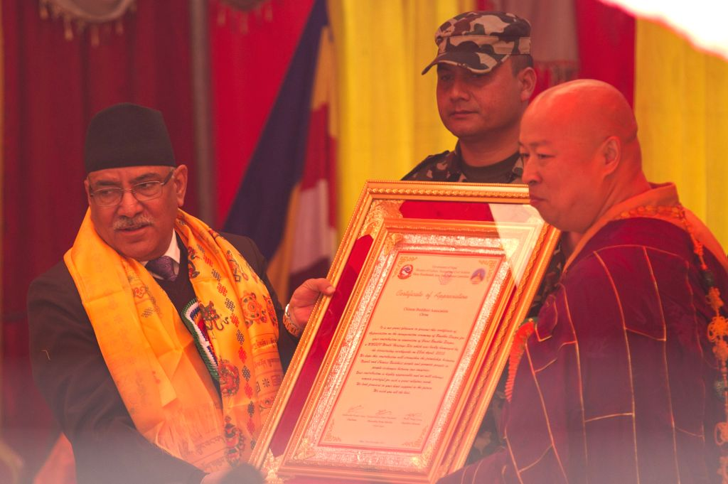 KATHMANDU, Nov. 22, 2016 - Nepali Prime Minister Pushpa Kamal Dahal (L) provides a gift to a monk during the inauguration ceremony of Boudhanath Stupa in Kathmandu, Nepal, Nov. 22, 2016. After a ... - Pushpa Kamal Dahal