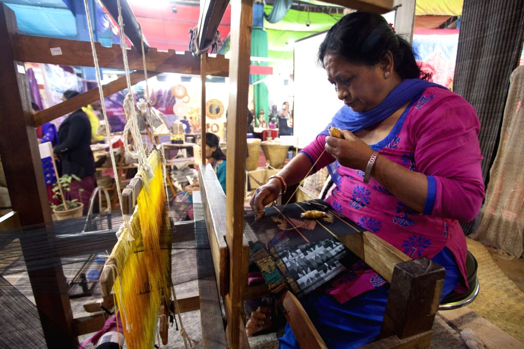 KATHMANDU, Nov. 26, 2016 - A Nepalese woman makes cloths during the 14th Handicraft Trade Fair and 12th Craft competition at Bhrikutimandap, Kathmandu, capital of Nepal, Nov. 25, 2016. Federation of ...