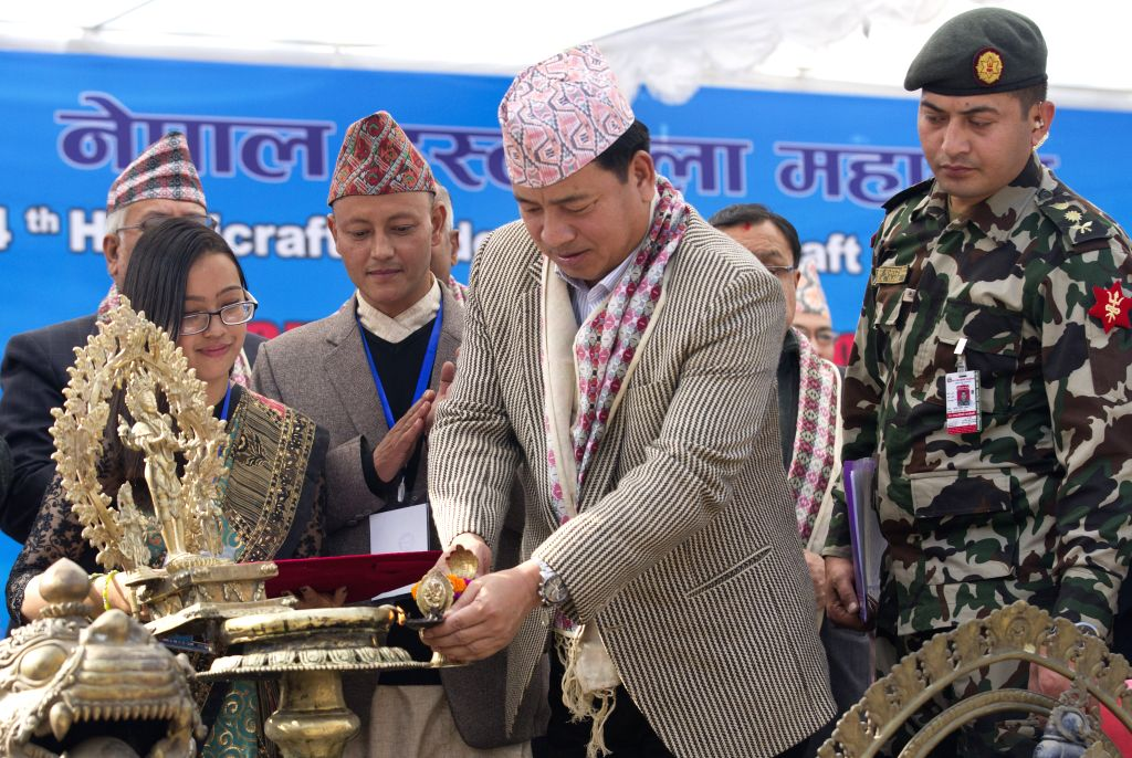 KATHMANDU, Nov. 26, 2016 - Nepalese Vice President Nanda Kishor Pun (2nd R, front) inaugurates the 14th Handicraft Trade Fair and 12th Craft competition at Bhrikutimandap, Kathmandu, capital of ...