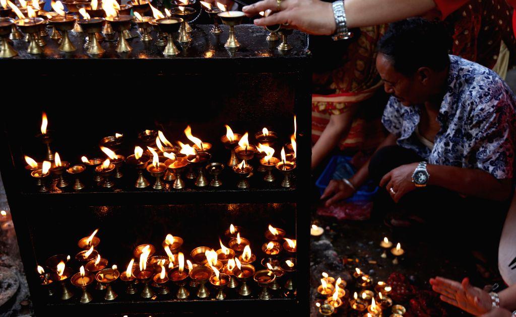 KATHMANDU, Oct. 10, 2016 - Nepali Hindu devotees offer prayers to Goddess Durga on Maha Astami, the eighth day of the Dashain festival at Maitidevi Temple in Kathmandu, Nepal, Oct. 9, 2016. Hindus in ...