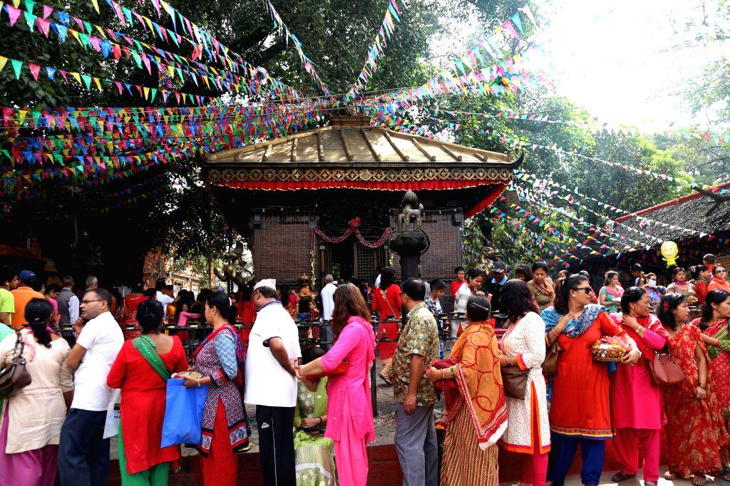 KATHMANDU, Oct. 10, 2016 - Nepali Hindu devotees queue up to offer prayers to Goddess Durga on Maha Astami, the eighth day of the Dashain festival at Maitidevi Temple in Kathmandu, Nepal, Oct. 9, ...