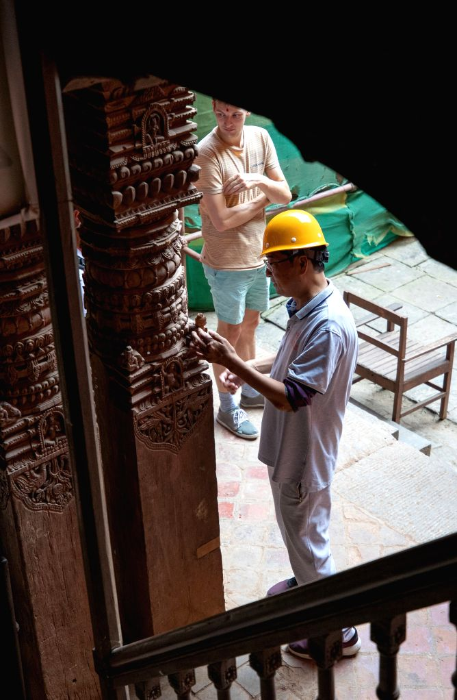 KATHMANDU, Oct. 11, 2019 - Zhou Jianguo, the technical chief of the Chinese restoration team, works at the restoration site of the nine-storeyed Basantapur complex in Kathmandu, Nepal, on Oct. 10, ...