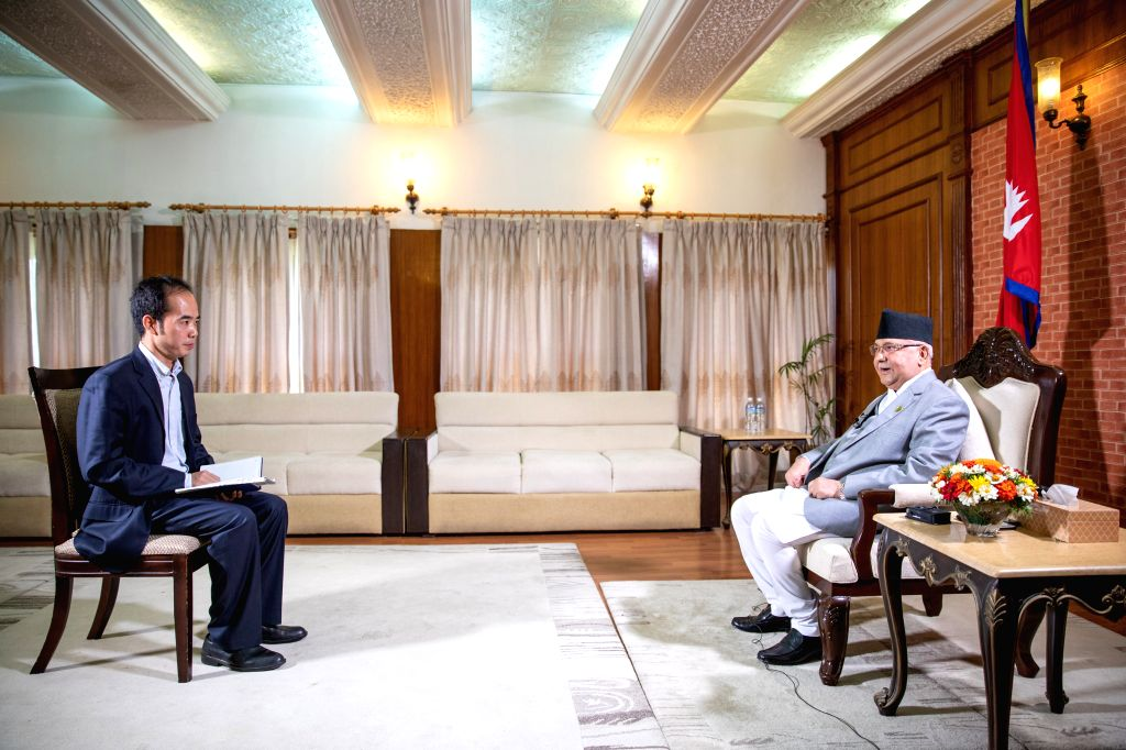 KATHMANDU, Oct. 12, 2019 - Nepali Prime Minister K.P. Sharma Oli receives an interview with Xinhua and other Chinese media in Kathmandu, Nepal, Oct. 11, 2019. Chinese President Xi Jinping's upcoming ... - K. and P. Sharma Oli