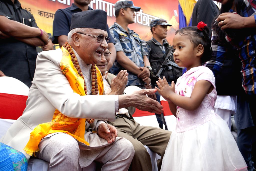 KATHMANDU, Oct. 16, 2016 - A little girl greets former Nepalese Prime Minister and Chairman of the Communist Party of Nepal (Unified Marxist-Leninist) (CPN-UML) Khadga Prashad Sharma Oli (L, front) ...
