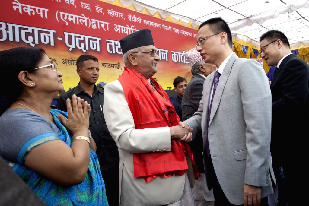 KATHMANDU, Oct. 16, 2016 - Former Nepalese Prime Minister and Chairman of the Communist Party of Nepal (Unified Marxist-Leninist) (CPN-UML) Khadga Prashad Sharma Oli (2n L, front) shakes hands with ...