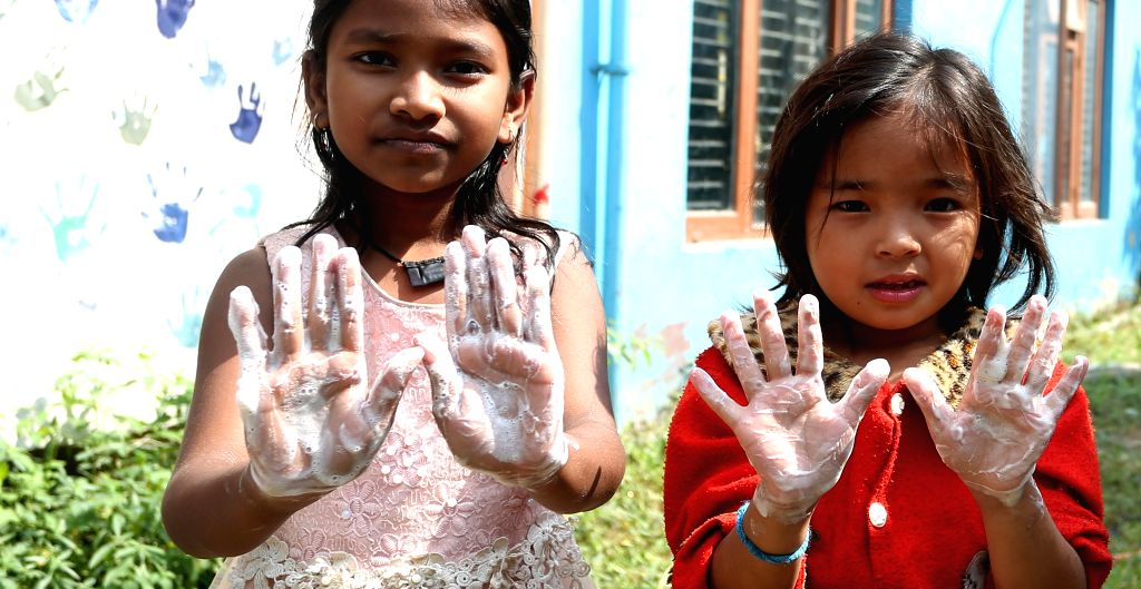 KATHMANDU, Oct. 16, 2019 - Nepalese kids show soapy hands as they learn to wash hands during an event to mark Global Handwashing Day in Kathmandu, Nepal, Oct. 15, 2019. Global Handwashing Day is an ...