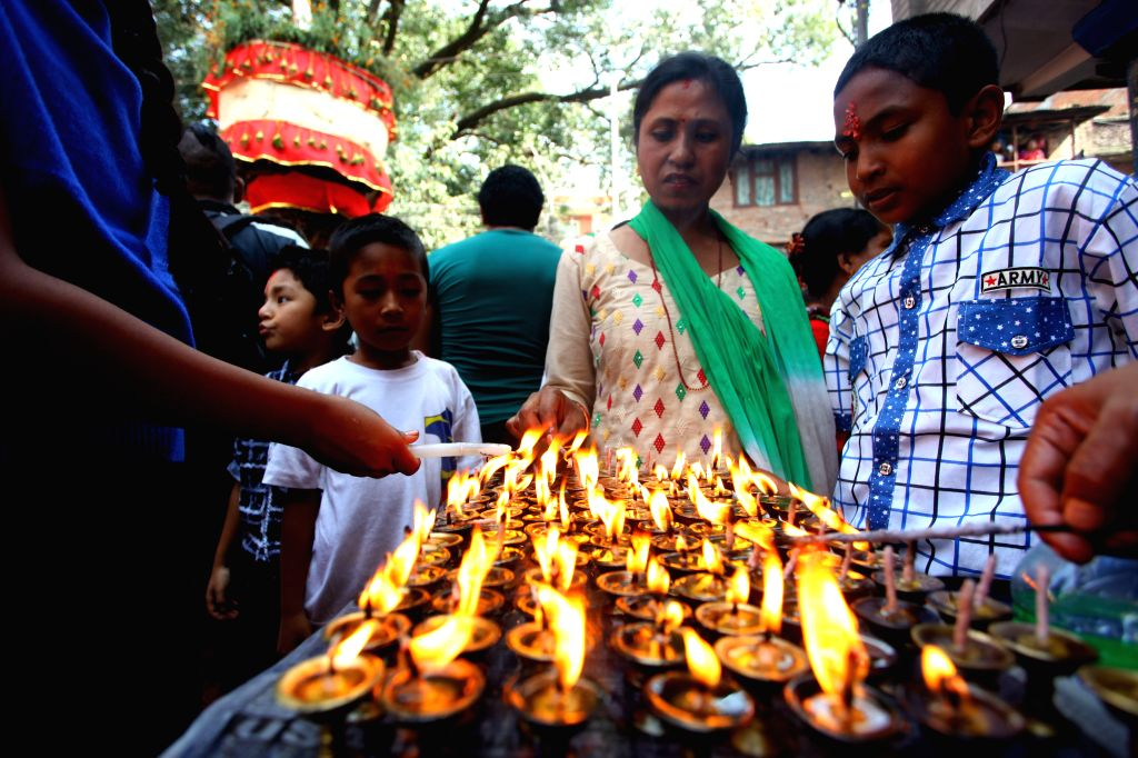 KATHMANDU, Oct. 17, 2016 - Local devotees offer prayers during the celebration of Hadigaun festival at the streets of Hadigaun in Kathmandu, Nepal, Oct. 17, 2016. The festival is celebrated annually ...
