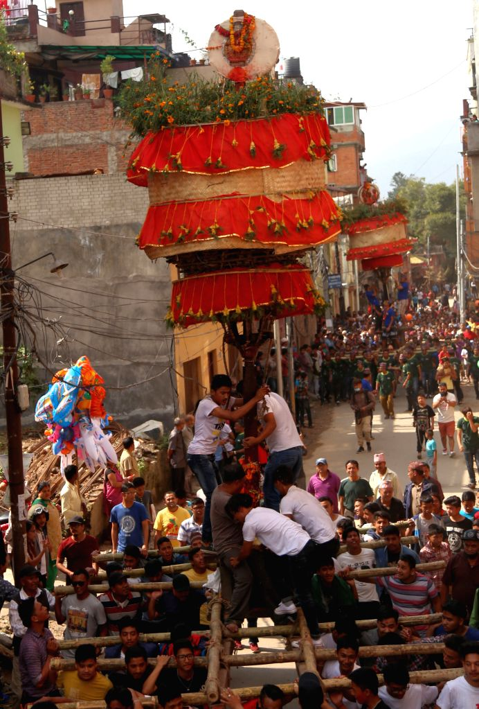 KATHMANDU, Oct. 17, 2016 - Local people carry the unique traditional chariots of deity Narayan during the celebration of Hadigaun festival at the streets of Hadigaun in Kathmandu, Nepal, Oct. 17, ...