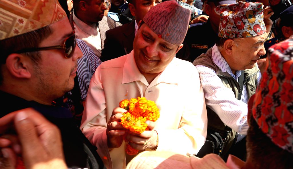 "KATHMANDU, Oct. 2, 2016 - Nepal's former King Gyanendra Shah (C) receives flowers from well-wishers during his arrival for offering prayers to ""Pachali Bhairav"" after revealing the new gold ... - Gyanendra Shah"
