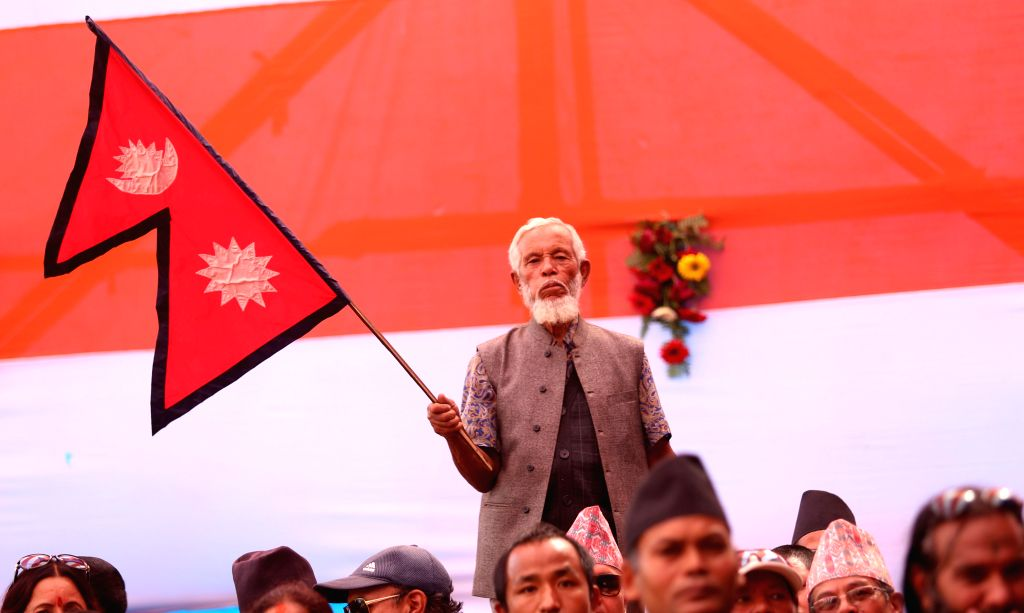 KATHMANDU, Oct. 20, 2016 - A participant waves the national flag during the inaugural of the Third International Grand Hindu Convention 2016 in Kathmandu, Nepal, Oct. 20, 2016. This is the first ...