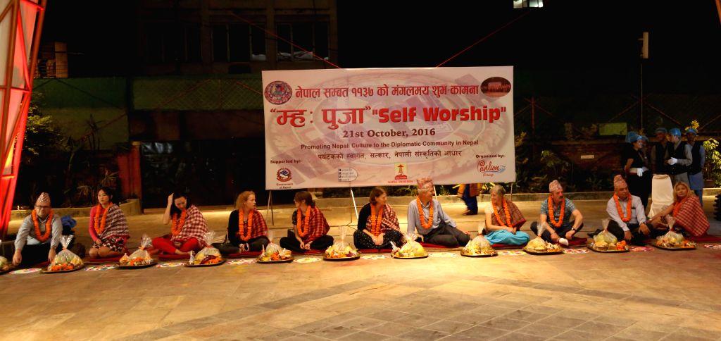 "KATHMANDU, Oct. 22, 2016 - Foreign diplomats participate in the celebration of ""Mha Puja"" in Kathmandu, capital of Nepal, Oct. 21, 2016. The celebration of ""Mha Puja"" was ..."
