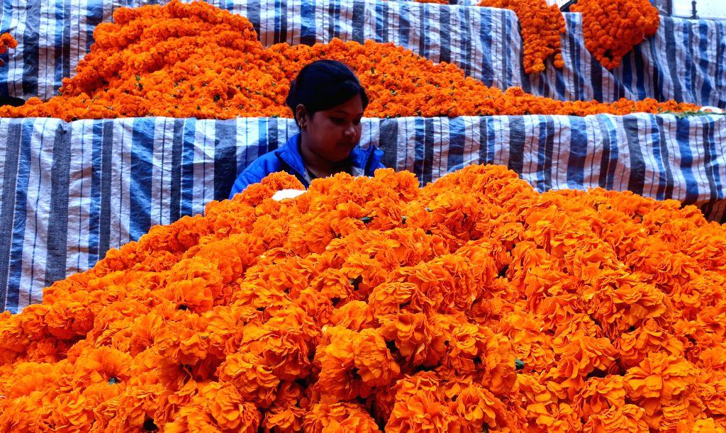 KATHMANDU, Oct. 27, 2019 - A woman prepares garlands of marigold flowers for Tihar festival at a market in Kathmandu, Nepal, Oct. 26, 2019.