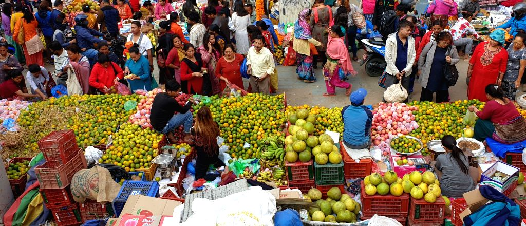 KATHMANDU, Oct. 27, 2019 - Local vendors sell fruits for the Tihar festival at a market in Kathmandu, Nepal, Oct. 26,2019.