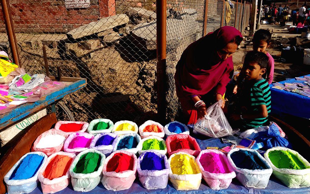 KATHMANDU, Oct. 28, 2016 - A street vendor sells color powders for Tihar festival at Hanuman Dhoka Durbar Square in Kathmandu, Nepal, Oct. 28, 2016.