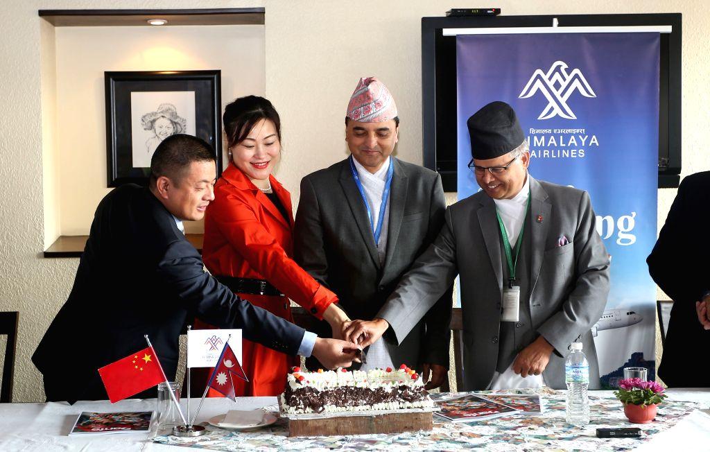 KATHMANDU, Oct. 28, 2019 - Nepali Minister for Culture, Tourism and Civil Aviation Yogesh Bhattarai (2nd R) and Chinese Ambassador to Nepal Hou Yanqi (2nd L) attend the Himalaya Airlines ...