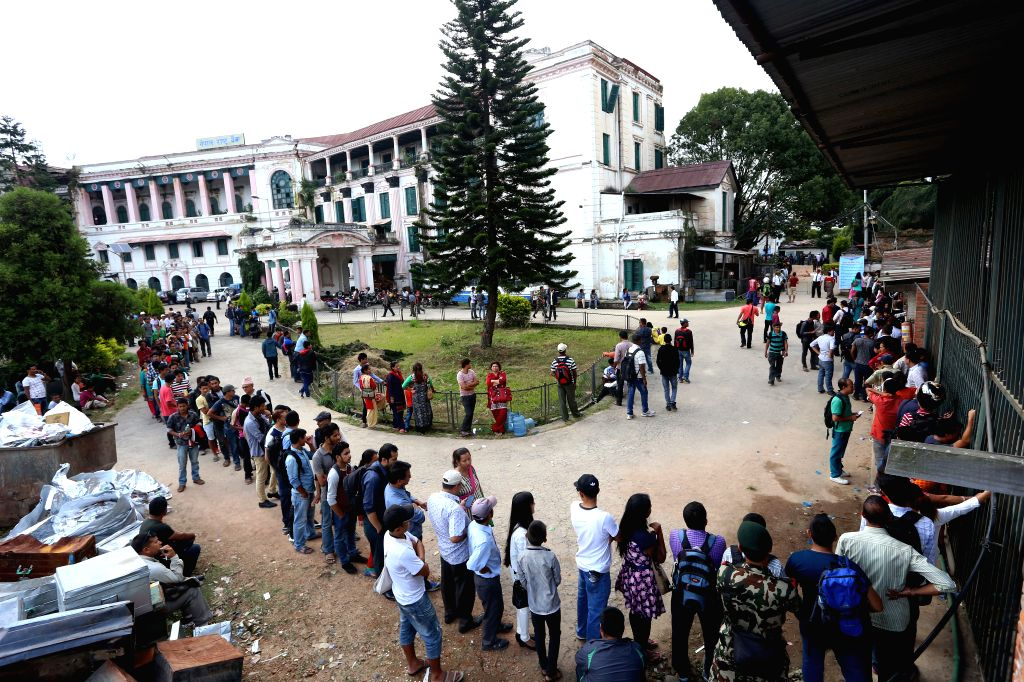 KATHMANDU, Oct. 3, 2016 - Nepalese people queue to exchange new banknotes offered by Nepal Rastra Bank (NRB), the central bank of Nepal, for Dashain festival in Kathmandu, Nepal, Oct. 3, 2016. ...