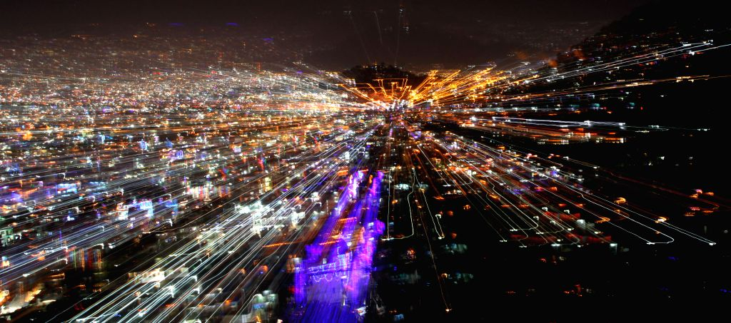 KATHMANDU, Oct. 30, 2016 - Photo taken on Oct. 30, 2016 shows the illuminating lights coming from the houses of Kathmandu Valley during Laxmi Puja, the third day of the Tihar festival, as seen from ...