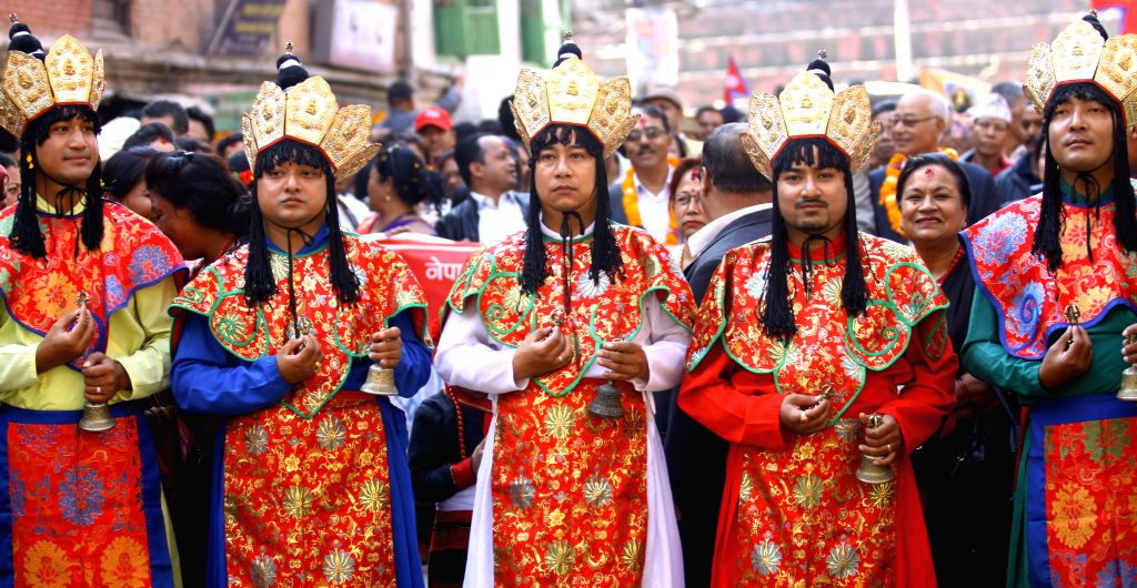 KATHMANDU, Oct. 31, 2016 - Priests from ethnic Newar community participate in a cultural rally staged on the occasion of New Year 1137 of Nepal Sambat at Hanuman Dhoka in Kathmandu, Nepal, Oct. 31, ...