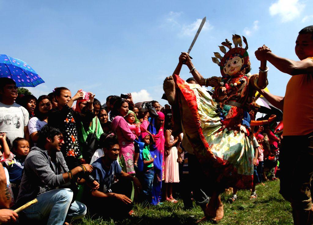 KATHMANDU, Oct. 7, 2016 - A Nepali Hindu devotee dressed as a deity performs during the celebration of Shikali Jatra Festival near Shikali temple at Khokana, on the outskirts of Kathmandu, Nepal, ...