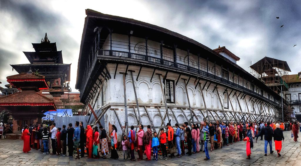 KATHMANDU, Oct. 7, 2019 - People queue to offer prayers to Goddess Durga on Nawami, the ninth day of Dashain festival, at a temple in Kathmandu, Nepal, Oct. 7, 2019.