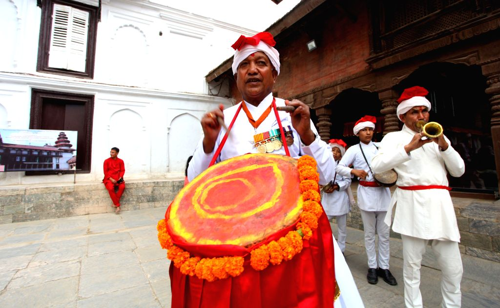 """KATHMANDU, Oct. 8, 2016 - Devotees play traditional music during a religious ceremony to celebrate """"Fulpati"""", the seventh day of the Dashain festival at Hanumandhoka Durbar Square in ..."""