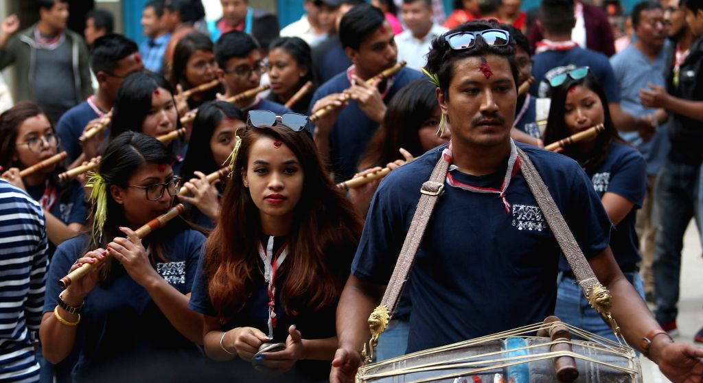 KATHMANDU, Oct. 9, 2019 - Nepalese youth play music during Sword Procession in a victory parade in Kathmandu, Nepal, Oct. 8, 2019. Hindus in Nepal celebrate victory over evil during Dashain Festival ...