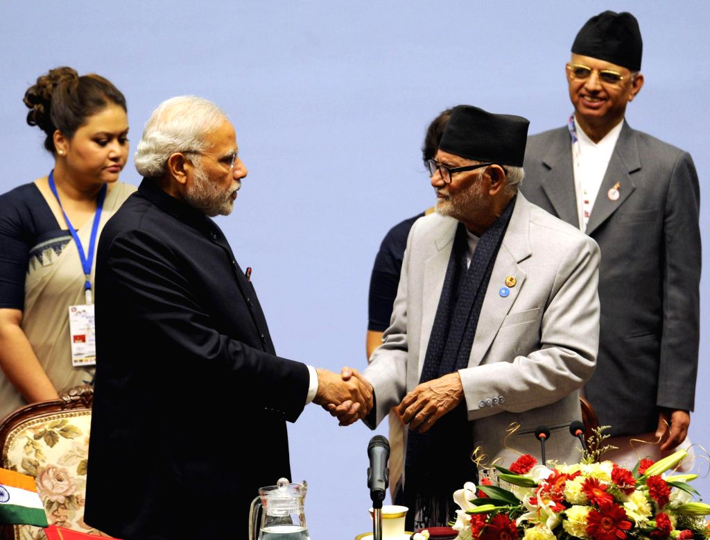 Prime Minister Narendra Modi with the Prime Minister of Nepal, Sushil Koirala at the inaugural session of the 18th SAARC Summit, in Kathmandu, Nepal, on Nov 26, 2014. - Narendra Modi