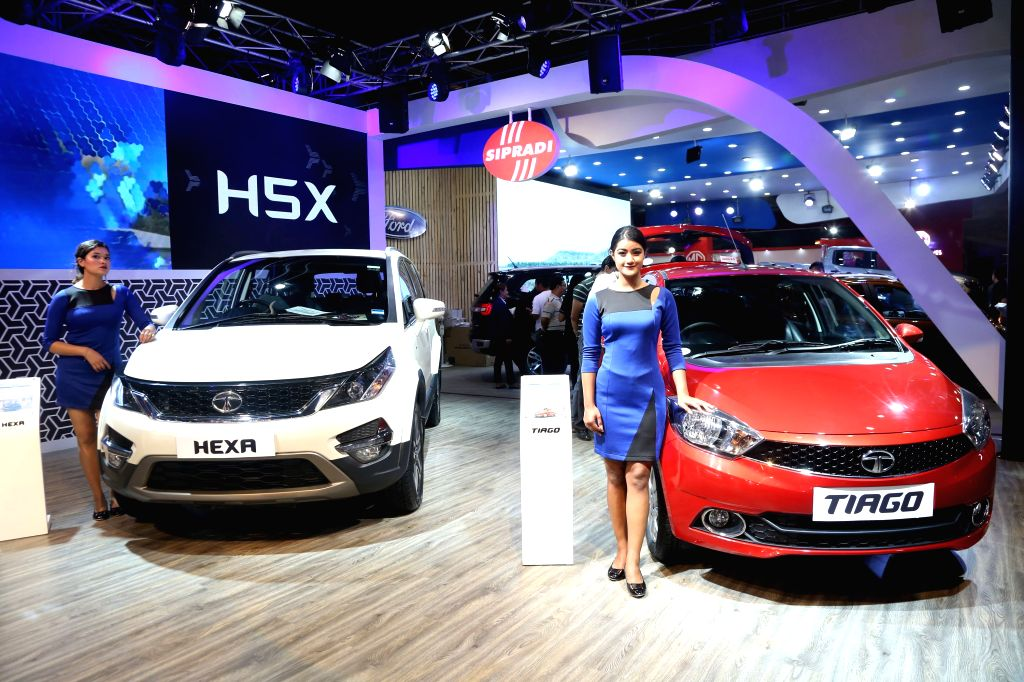 KATHMANDU, Sept. 11, 2018 - Models pose with cars at the Nepal Automobile Dealers' Association (NADA) Auto Show 2018 in Kathmandu, capital of Nepal, Sept. 11, 2018. The 13th NADA Auto Show aims at ...