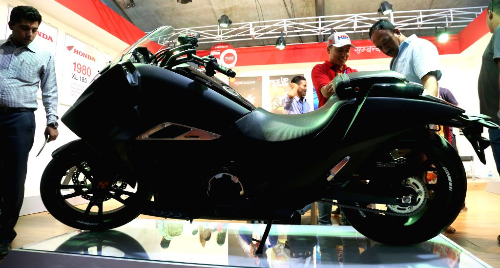 KATHMANDU, Sept. 11, 2018 - Visitors look at the new model of a motorcycle at the Nepal Automobile Dealers' Association (NADA) Auto Show 2018 in Kathmandu, capital of Nepal, Sept. 11, 2018. The 13th ...