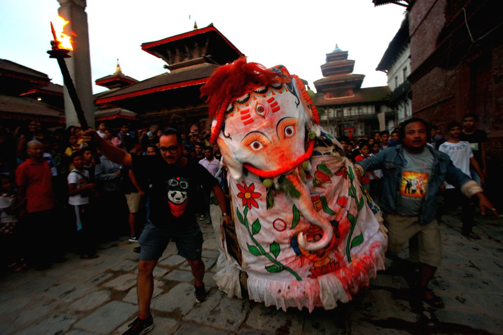 "KATHMANDU, Sept. 14, 2016 - An elephant-masked performer ""Pulukisi"" performs on the first day of Indrajatra Festival in Kathmandu, Nepal, Sept. 13, 2016. Nepalese celebrate the Indrajatra ..."