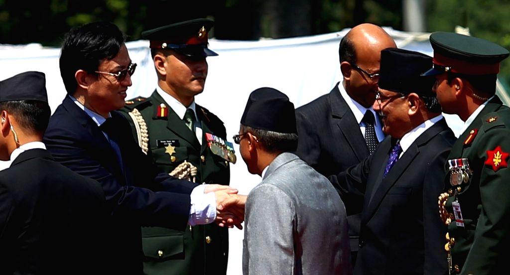 KATHMANDU, Sept. 15, 2016 - Chinese Ambassador to Nepal Wu Chuntai (2nd L) bids farewell to Nepalese Prime Minister Pushpa Kamal Dahal (2nd R) at the Tribhuwan International Airport in Kathmandu, ... - Pushpa Kamal Dahal