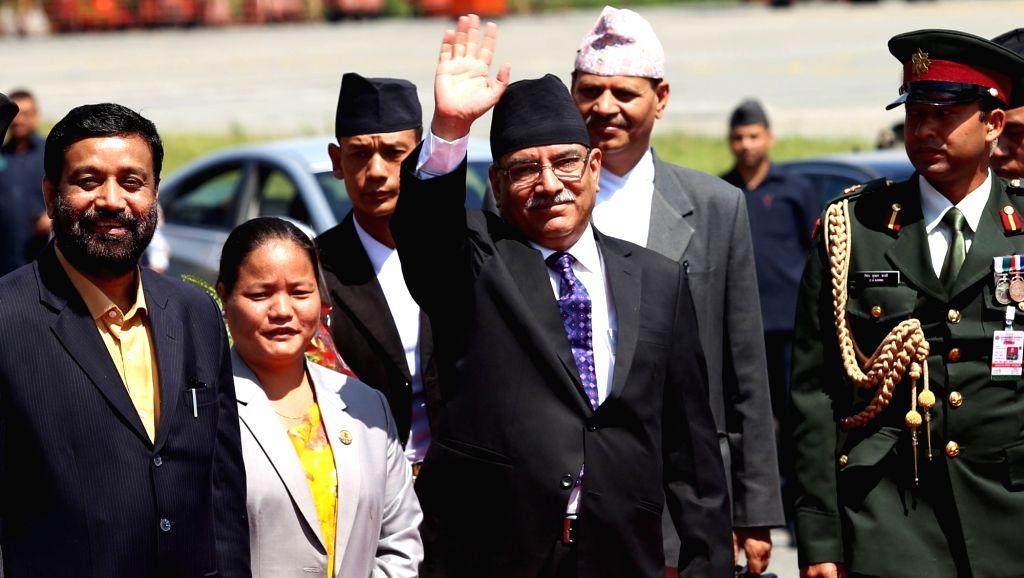 KATHMANDU, Sept. 15, 2016 - Nepalese Minister Pushpa Kamal Dahal (C) waves before leaving for India at the Tribhuwan International Airport in Kathmandu, Nepal,Sept. 15, 2016. Nepalese Prime Minister ... - Pushpa Kamal Dahal